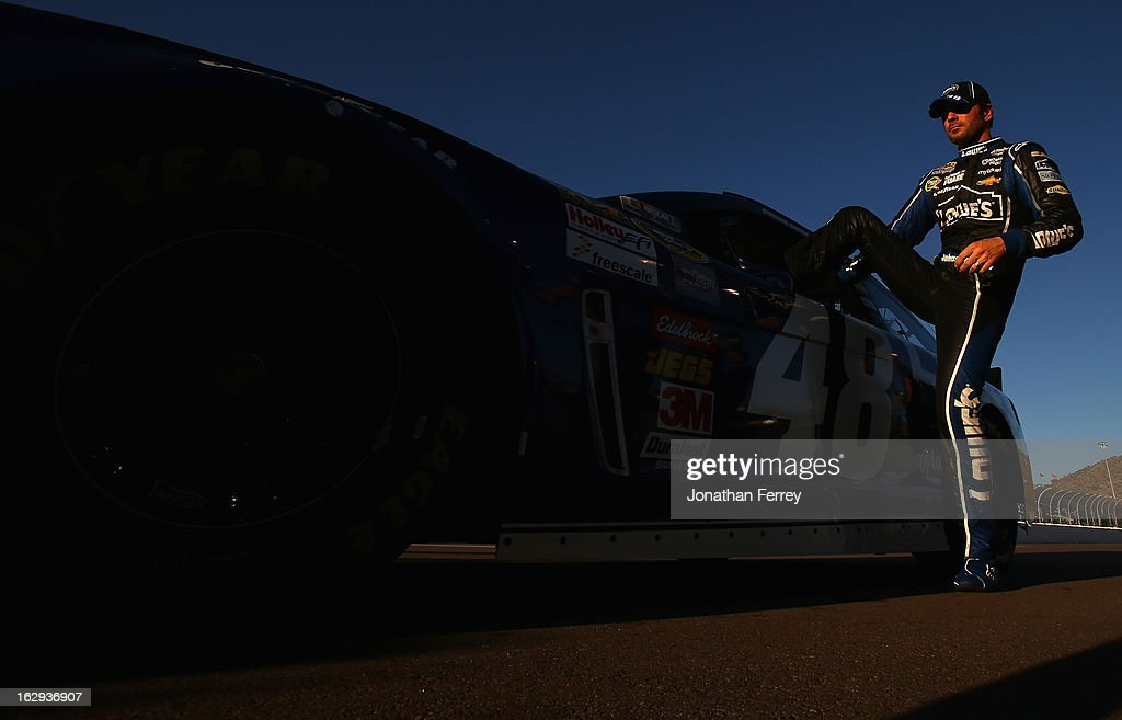 Jimmie Johnson, driver of the #48 Lowe's Chevrolet, gets into his car during qualifying for the NASCAR Sprint Cup Series Subway Fresh Fit 500 at Phoenix International Raceway on March 1, 2013 in Avondale, Arizona.