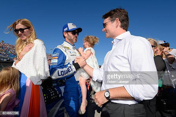 Jimmie Johnson driver of the Lowe's Chevrolet greets Jeff Gordon on the grid during prerace ceremonies for the NASCAR Sprint Cup Series Ford EcoBoost...