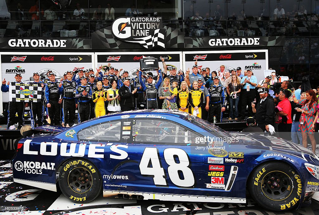 Jimmie Johnson, driver of the #48 Lowe's Chevrolet, hoists the Harley J. Earl trophy after winning the NASCAR Sprint Cup Series Daytona 500 at Daytona International Speedway on February 24, 2013 in Daytona Beach, Florida.
