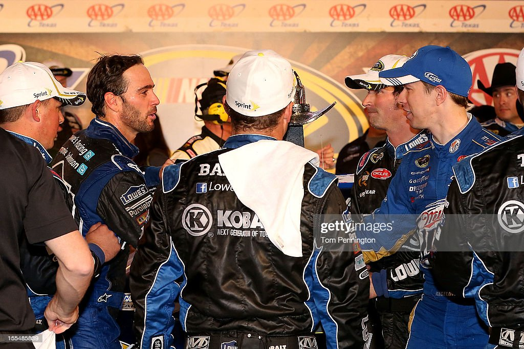 <a gi-track='captionPersonalityLinkClicked' href=/galleries/search?phrase=Jimmie+Johnson+-+Pilota+Nascar&family=editorial&specificpeople=171519 ng-click='$event.stopPropagation()'>Jimmie Johnson</a>, driver of the #48 Lowe's Chevrolet, is congratulated by <a gi-track='captionPersonalityLinkClicked' href=/galleries/search?phrase=Brad+Keselowski&family=editorial&specificpeople=890258 ng-click='$event.stopPropagation()'>Brad Keselowski</a>, driver of the #2 Miller Lite Dodge, in Victory Lane after winning the NASCAR Sprint Cup Series AAA Texas 500 at Texas Motor Speedway on November 4, 2012 in Fort Worth, Texas.