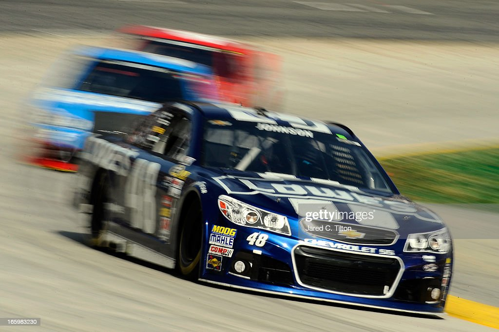 Jimmie Johnson, driver of the #48 Lowe's Chevrolet, leads a group of cars during the NASCAR Sprint Cup Series STP Gas Booster 500 on April 7, 2013 at Martinsville Speedway in Ridgeway, Virginia.