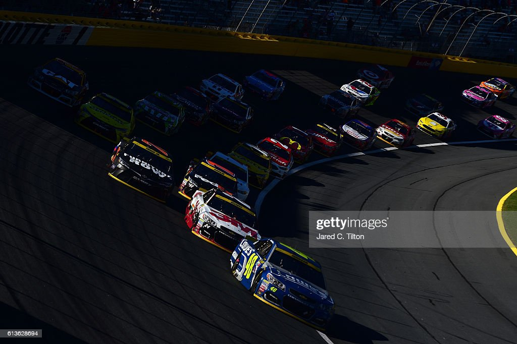 Jimmie Johnson, driver of the #48 Lowe's Chevrolet, leads a pack of cars during the NASCAR Sprint Cup Series Bank of America 500 at Charlotte Motor Speedway on October 9, 2016 in Charlotte, North Carolina.
