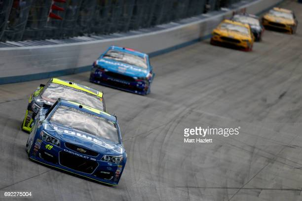 Jimmie Johnson driver of the Lowe's Chevrolet leads a pack of cars during the Monster Energy NASCAR Cup Series AAA 400 Drive for Autism at Dover...