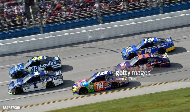 Jimmie Johnson driver of the Lowe's Chevrolet leads a pack of cars during the Monster Energy NASCAR Cup Series Alabama 500 at Talladega Superspeedway...