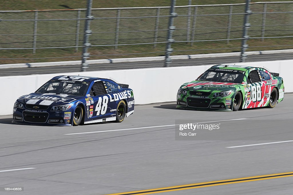Jimmie Johnson, driver of the #48 Lowe's Chevrolet, leads Dale Earnhardt Jr., driver of the #88 Mountain Dew / XBox One Chevrolet, during the NASCAR Sprint Cup Series Camping World RV Sales 500 at Talladega Superspeedway on October 20, 2013 in Talladega, Alabama.