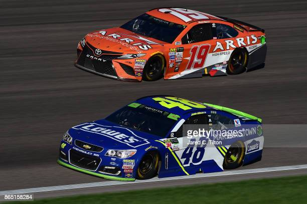 Jimmie Johnson driver of the Lowe's Chevrolet leads Daniel Suarez driver of the ARRIS Toyota during the Monster Energy NASCAR Cup Series Hollywood...