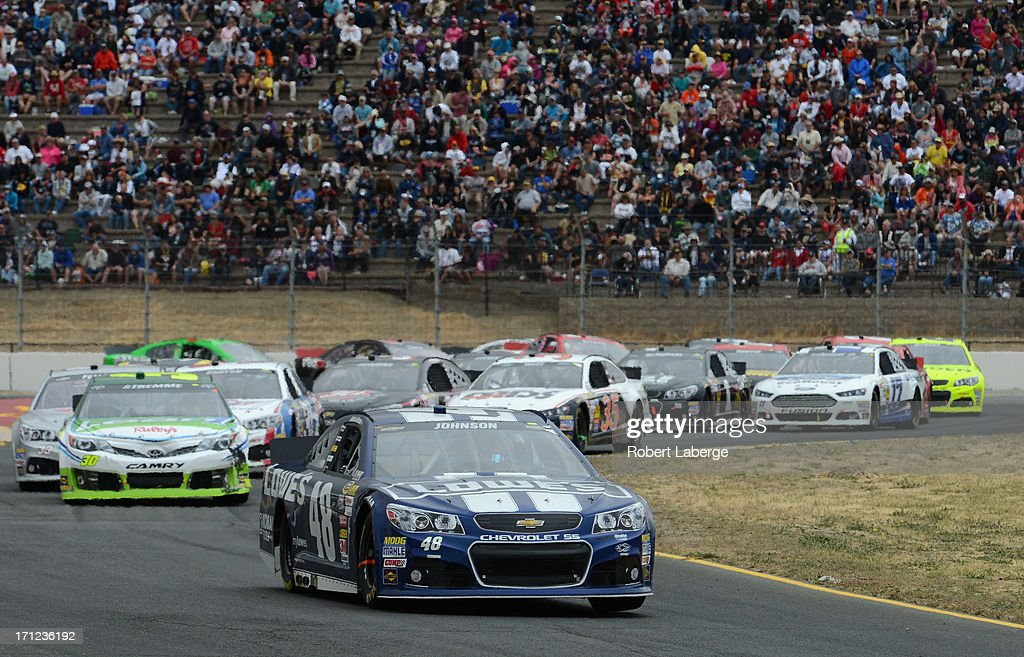 Jimmie Johnson, driver of the #48 Lowe's Chevrolet, leads David Stremme, driver of the #30 Lean 1 / Swan Energy Toyota, during the NASCAR Sprint Cup Series Toyota/Save Mart 350 at Sonoma Raceway on June 23, 2013 in Sonoma, California.