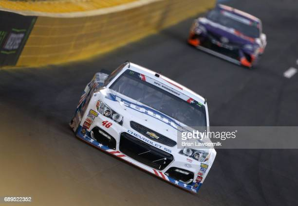 Jimmie Johnson driver of the Lowe's Chevrolet leads Denny Hamlin driver of the FedEx Office Toyota during the Monster Energy NASCAR Cup Series...