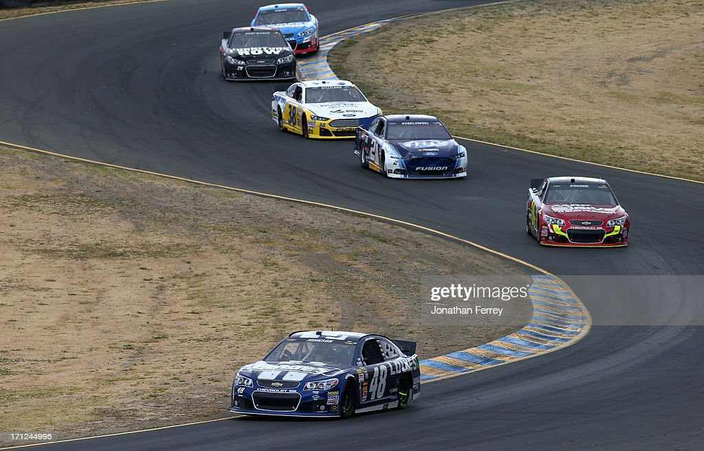 Jimmie Johnson, driver of the #48 Lowe's Chevrolet, leads Jeff Gordon, driver of the #24 Drive To End Hunger Chevrolet, during the NASCAR Sprint Cup Series Toyota/Save Mart 350 at Sonoma Raceway on June 23, 2013 in Sonoma, California.