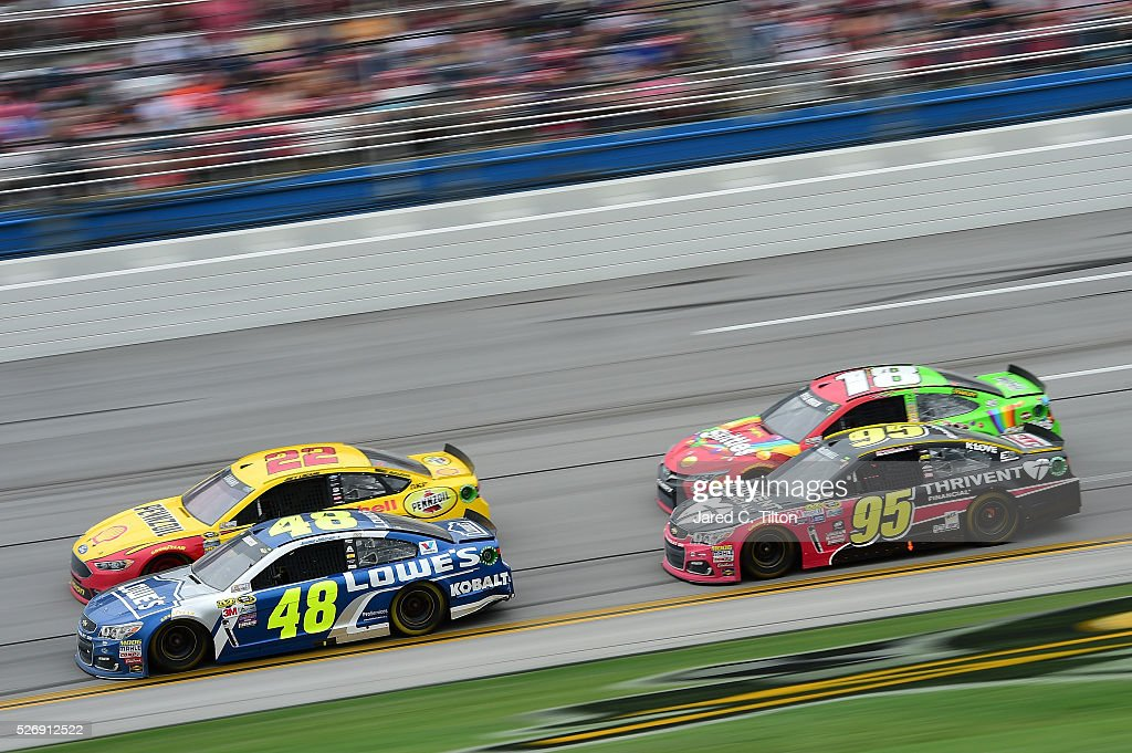 <a gi-track='captionPersonalityLinkClicked' href=/galleries/search?phrase=Jimmie+Johnson+-+Nascar-Pilot&family=editorial&specificpeople=171519 ng-click='$event.stopPropagation()'>Jimmie Johnson</a>, driver of the #48 Lowe's Chevrolet, leads <a gi-track='captionPersonalityLinkClicked' href=/galleries/search?phrase=Joey+Logano&family=editorial&specificpeople=4510426 ng-click='$event.stopPropagation()'>Joey Logano</a>, driver of the #22 Shell Pennzoil Ford, ahead of <a gi-track='captionPersonalityLinkClicked' href=/galleries/search?phrase=Michael+McDowell+-+Rennfahrer&family=editorial&specificpeople=12880477 ng-click='$event.stopPropagation()'>Michael McDowell</a>, driver of the #95 Thrivent Financial Chevrolet, and <a gi-track='captionPersonalityLinkClicked' href=/galleries/search?phrase=Kyle+Busch&family=editorial&specificpeople=211123 ng-click='$event.stopPropagation()'>Kyle Busch</a>, driver of the #18 Skittles Marvel Toyota, during the NASCAR Sprint Cup Series GEICO 500 at Talladega Superspeedway on May 1, 2016 in Talladega, Alabama.