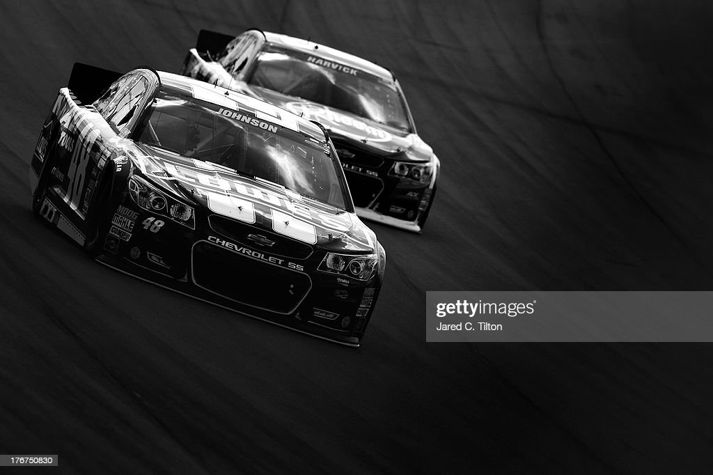 Jimmie Johnson, driver of the #48 Lowe's Chevrolet, leads Kevin Harvick, driver of the #29 Rheem Chevrolet, during the NASCAR Sprint Cup Series 44th Annual Pure Michigan 400 at Michigan International Speedway on August 18, 2013 in Brooklyn, Michigan.