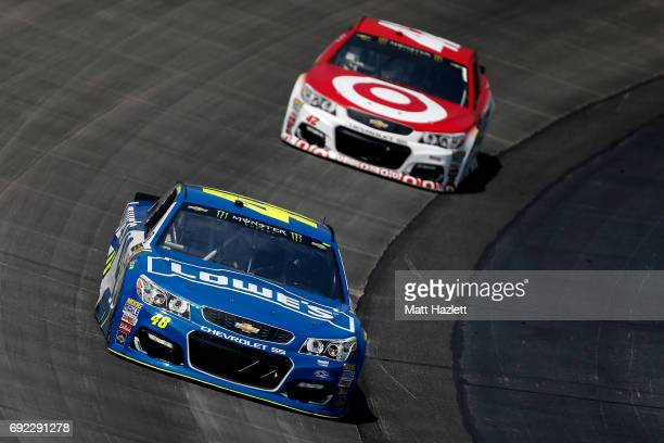 Jimmie Johnson driver of the Lowe's Chevrolet leads Kyle Larson driver of the Target Chevrolet during the Monster Energy NASCAR Cup Series AAA 400...