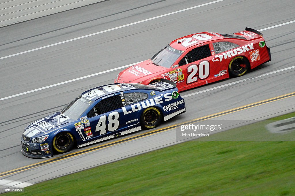 Jimmie Johnson, driver of the #48 Lowe's Chevrolet, leads Matt Kenseth, driver of the #20 Home Depot / Husky Toyota, during the NASCAR Sprint Cup Series Aaron's 499 at Talladega Superspeedway on May 5, 2013 in Talladega, Alabama.
