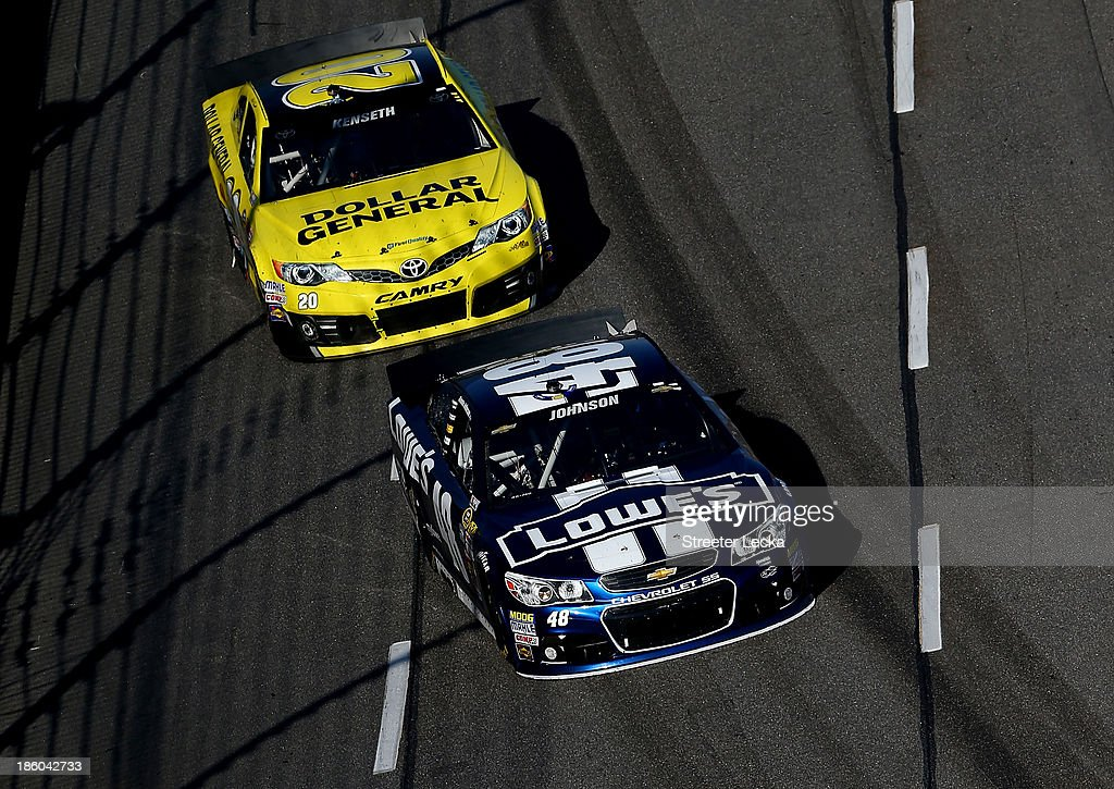 Jimmie Johnson, driver of the #48 Lowe's Chevrolet, leads <a gi-track='captionPersonalityLinkClicked' href=/galleries/search?phrase=Matt+Kenseth&family=editorial&specificpeople=204192 ng-click='$event.stopPropagation()'>Matt Kenseth</a>, driver of the #20 Dollar General Toyota, during the NASCAR Sprint Cup Series Goody's Headache Relief Shot 500 Powered By Kroger at Martinsville Speedway on October 27, 2013 in Martinsville, Virginia.