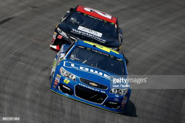Jimmie Johnson driver of the Lowe's Chevrolet leads Matt Kenseth driver of the ToyotaCare Toyota during the Monster Energy NASCAR Cup Series AAA 400...