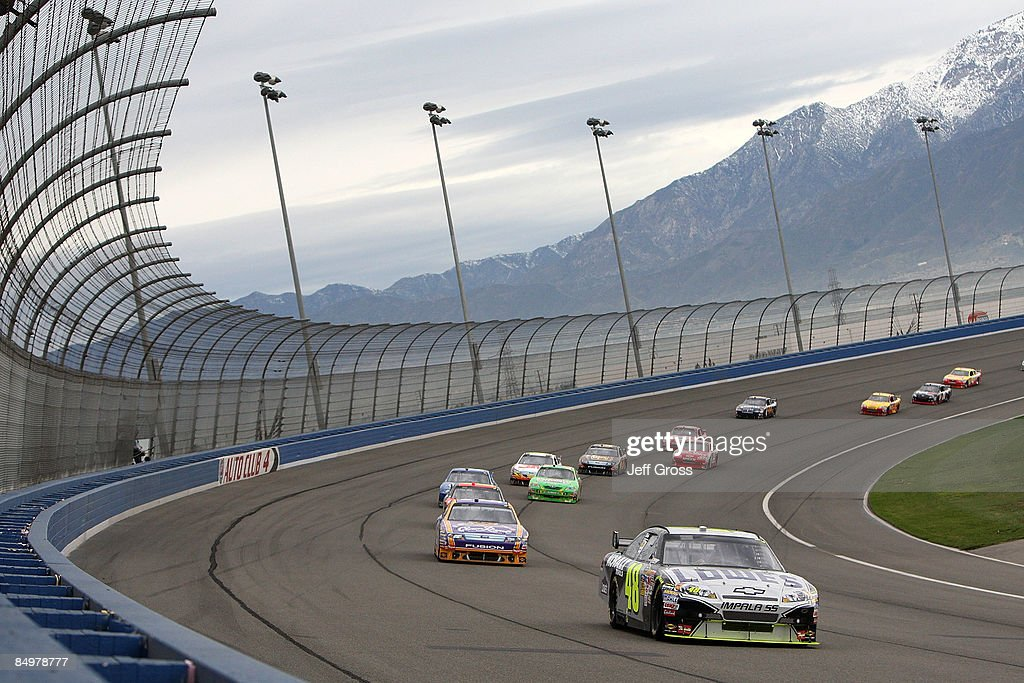 Jimmie Johnson driver of the Lowe's Chevrolet leads the field during the NASCAR Sprint Cup Series Auto Club 500 at Auto Club Speedway on February 22...