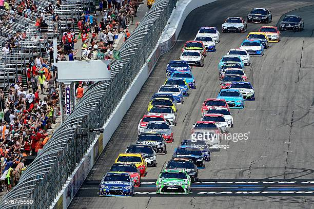 Jimmie Johnson driver of the Lowe's Chevrolet leads the field past the green flag to start the NASCAR Sprint Cup Series New Hampshire 301 at New...