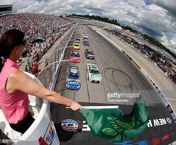 Jimmie Johnson driver of the Lowe's Chevrolet leads the field to the green flag to start the NASCAR Sprint Cup Series New Hampshire 301 at New...