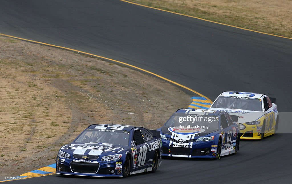 Jimmie Johnson, driver of the #48 Lowe's Chevrolet, leads Travis Kvapil, driver of the #93 Burger King/Dr. Pepper Toyota, and David Gilliland, driver of the #38 Long John Silver's Ford, during the NASCAR Sprint Cup Series Toyota/Save Mart 350 at Sonoma Raceway on June 23, 2013 in Sonoma, California.