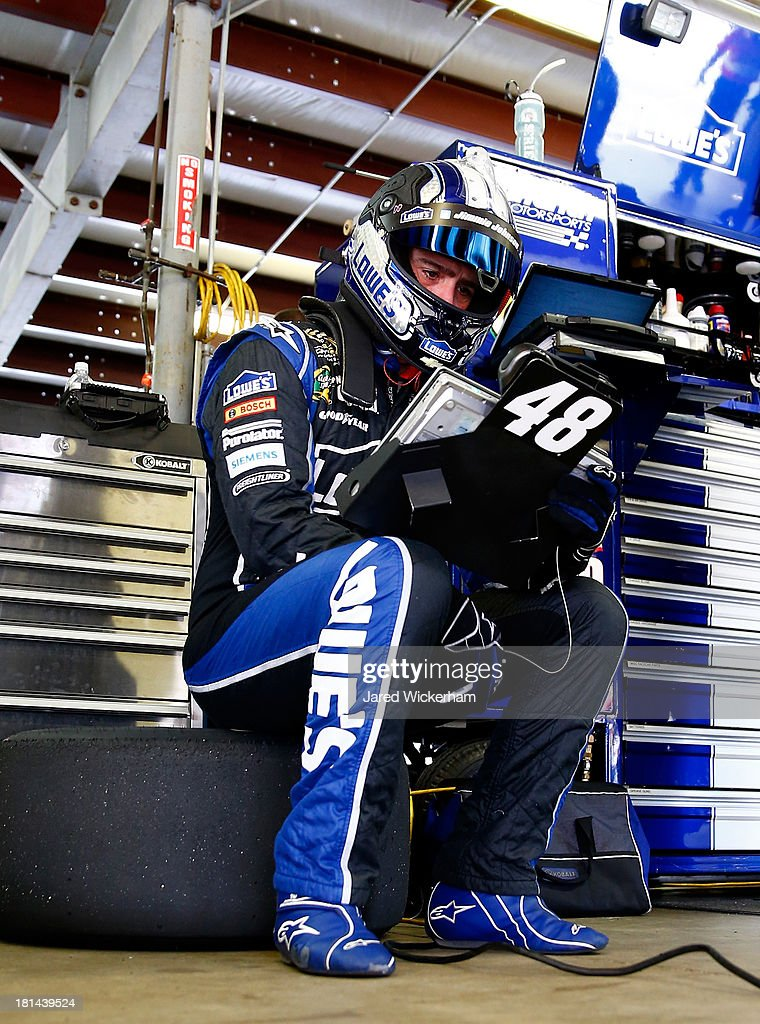 Jimmie Johnson, driver of the #48 Lowe's Chevrolet, looks at a computer screen in the garage during practice for the NASCAR Sprint Cup Series Sylvania 300 at New Hampshire Motor Speedway on September 21, 2013 in Loudon, New Hampshire.