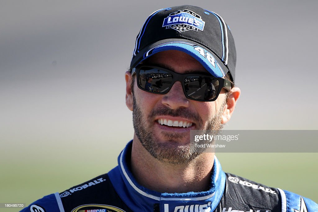 Jimmie Johnson, driver of the #48 Lowe's Chevrolet, looks on during qualifying for the NASCAR Sprint Cup Series Geico 400 at Chicagoland Speedway on September 13, 2013 in Joliet, Illinois.