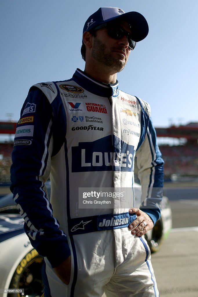 Jimmie Johnson, driver of the #48 Lowe's Chevrolet, looks on during qualifying for the NASCAR Sprint Cup Series Auto Club 400 at Auto Club Speedway on March 21, 2014 in Fontana, California.