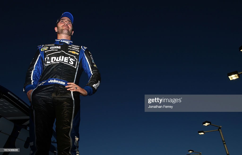 <a gi-track='captionPersonalityLinkClicked' href=/galleries/search?phrase=Jimmie+Johnson+-+Nascar-Pilot&family=editorial&specificpeople=171519 ng-click='$event.stopPropagation()'>Jimmie Johnson</a>, driver of the #48 Lowe's Chevrolet, looks on from the grid during qualifying for the NASCAR Sprint Cup Series Subway Fresh Fit 500 at Phoenix International Raceway on March 1, 2013 in Avondale, Arizona.
