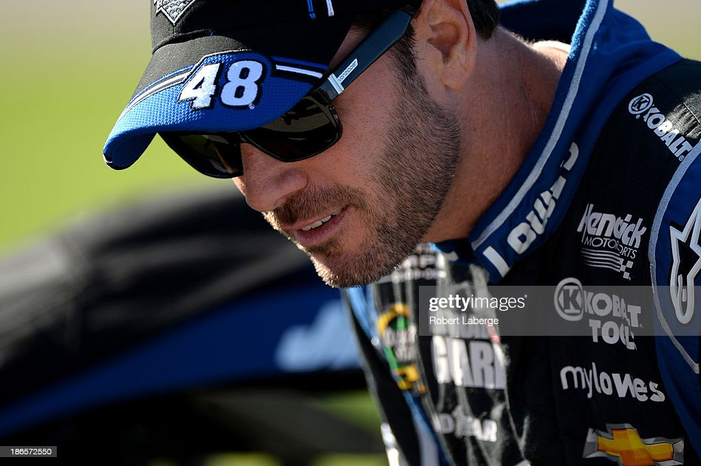 Jimmie Johnson, driver of the #48 Lowe's Chevrolet, looks on from the grid during qualifying for the NASCAR Sprint Cup Series AAA Texas 500 at Texas Motor Speedway on November 1, 2013 in Fort Worth, Texas.