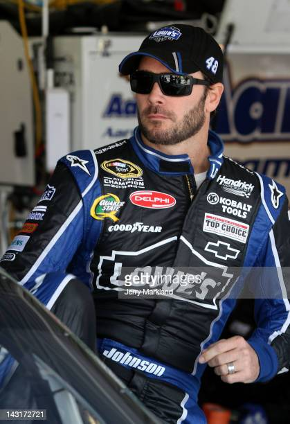 Jimmie Johnson driver of the Lowe's Chevrolet looks on in the garage during practice for the NASACAR Sprint Cup Series 400 at Kansas Speedway on...