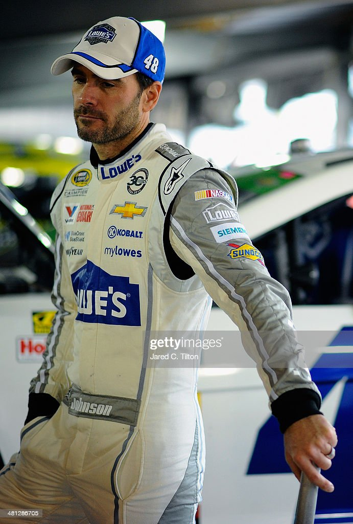 Jimmie Johnson, driver of the #48 Lowe's Chevrolet, looks on in the garage area during a rain delay in practice for the NASCAR Sprint Cup Series STP 500 at Martinsville Speedway on March 29, 2014 in Martinsville, Virginia.
