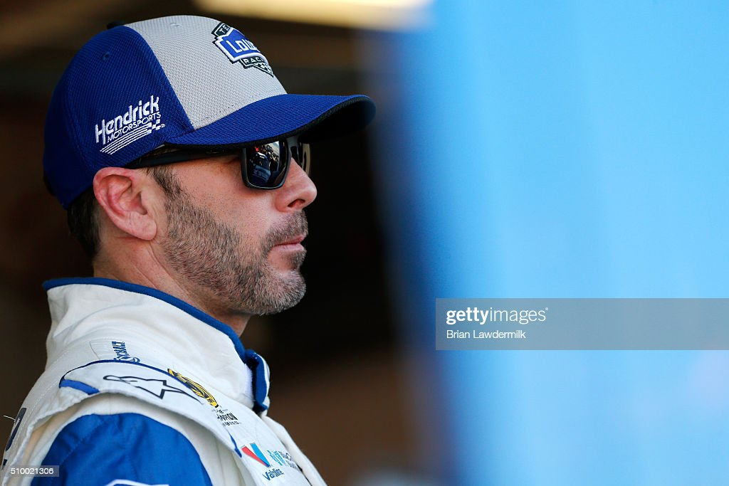 Jimmie Johnson, driver of the #48 Lowe's Chevrolet, looks on in the garage area during practice for the NASCAR Sprint Cup Series Daytona 500 at Daytona International Speedway on February 13, 2016 in Daytona Beach, Florida.