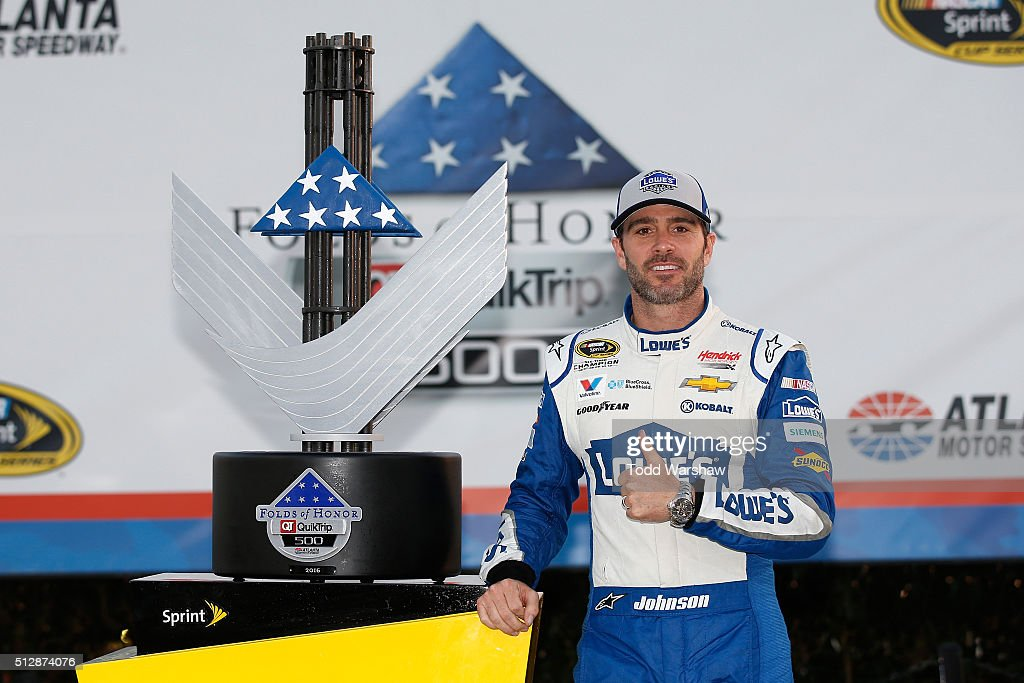 Jimmie Johnson, driver of the #48 Lowe's Chevrolet, poses in Victory Lane after winning the NASCAR Sprint Cup Series Folds of Honor QuikTrip 500 at Atlanta Motor Speedway on February 28, 2016 in Hampton, Georgia.