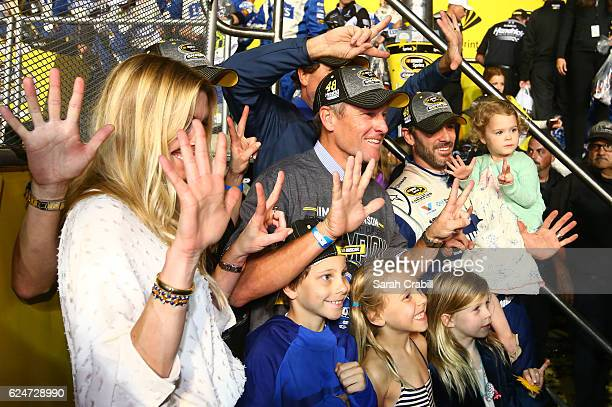 Jimmie Johnson driver of the Lowe's Chevrolet poses in Victory Lane with his wife Chandra daughters Genevieve Marie and Lydia Norriss and former...