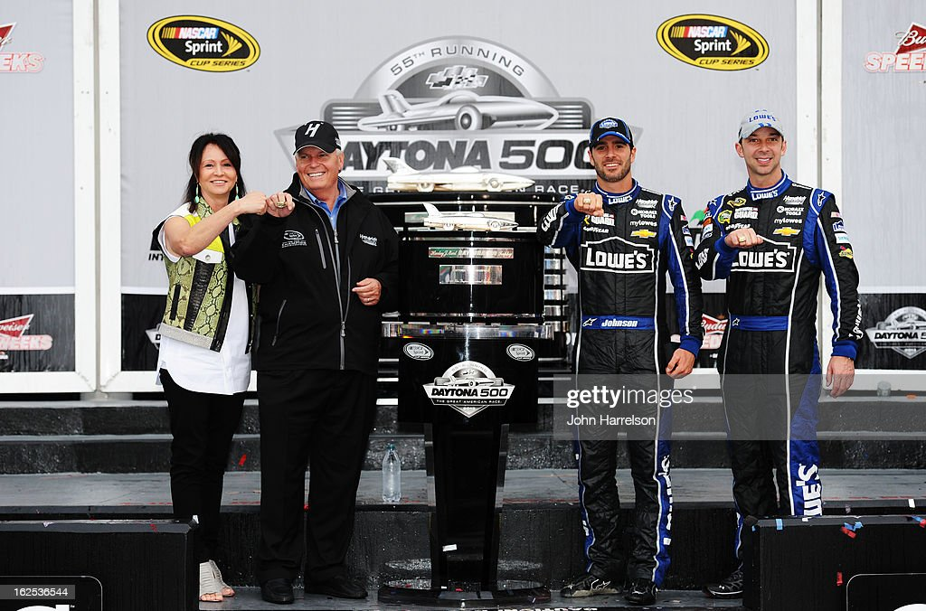 Jimmie Johnson, driver of the #48 Lowe's Chevrolet (R), poses with team owner Rick Hendrick and his wife Linda Hendrick and crew chief Chad Knaus (L) after winning the NASCAR Sprint Cup Series Daytona 500 at Daytona International Speedway on February 24, 2013 in Daytona Beach, Florida.
