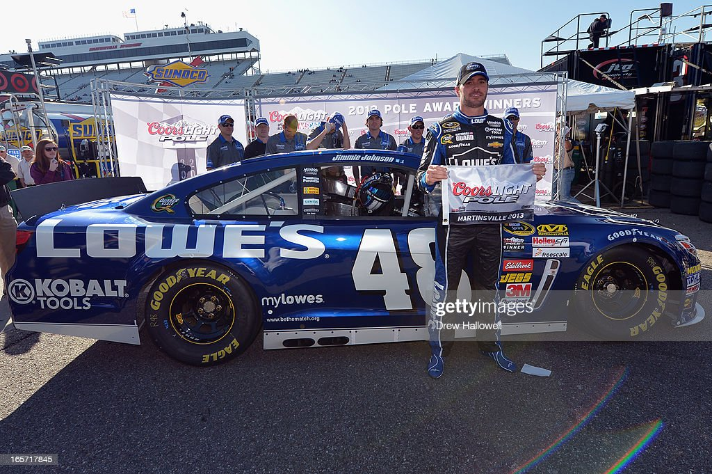 <a gi-track='captionPersonalityLinkClicked' href=/galleries/search?phrase=Jimmie+Johnson+-+Pilota+Nascar&family=editorial&specificpeople=171519 ng-click='$event.stopPropagation()'>Jimmie Johnson</a>, driver of the #48 Lowe's Chevrolet, poses with the Coors Light Pole Award after qualifying for pole position for the NASCAR Sprint Cup Series STP Gas Booster 500 on April 5, 2013 at Martinsville Speedway in Ridgeway, Virginia.