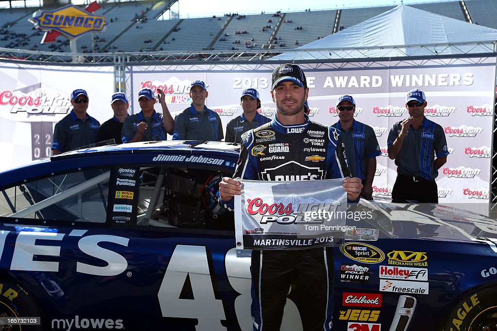 Jimmie Johnson, driver of the #48 Lowe's Chevrolet, poses with the Coors Light Pole Award after qualifying for the NASCAR Sprint Cup Series STP Gas Booster 500 on April 5, 2013 at Martinsville Speedway in Ridgeway, Virginia.