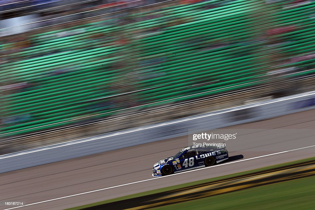 Jimmie Johnson, driver of the #48 Lowe's Chevrolet, practices for the NASCAR Sprint Cup Series 13th Annual Hollywood Casino 400 at Kansas Speedway on October 5, 2013 in Kansas City, Kansas.