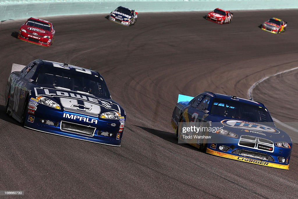 <a gi-track='captionPersonalityLinkClicked' href=/galleries/search?phrase=Jimmie+Johnson+-+Nascar+Race+Driver&family=editorial&specificpeople=171519 ng-click='$event.stopPropagation()'>Jimmie Johnson</a>, driver of the #48 Lowe's Chevrolet, races <a gi-track='captionPersonalityLinkClicked' href=/galleries/search?phrase=Brad+Keselowski&family=editorial&specificpeople=890258 ng-click='$event.stopPropagation()'>Brad Keselowski</a>, driver of the #2 Miller Lite Dodge, during the NASCAR Sprint Cup Series Ford EcoBoost 400 at Homestead-Miami Speedway on November 18, 2012 in Homestead, Florida.
