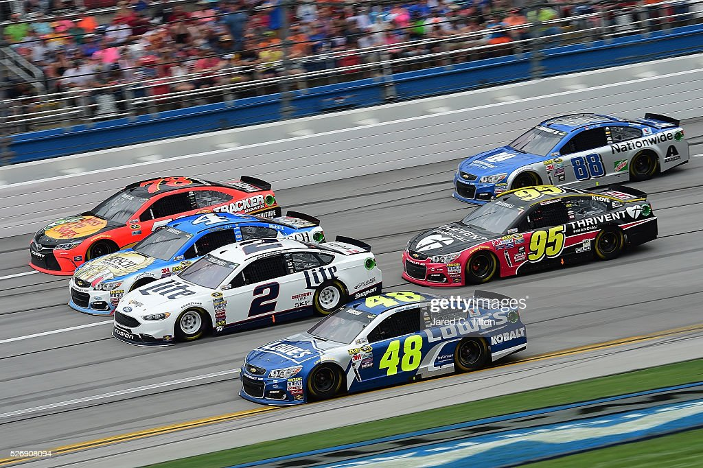 <a gi-track='captionPersonalityLinkClicked' href=/galleries/search?phrase=Jimmie+Johnson+-+Nascar+Race+Driver&family=editorial&specificpeople=171519 ng-click='$event.stopPropagation()'>Jimmie Johnson</a>, driver of the #48 Lowe's Chevrolet, races <a gi-track='captionPersonalityLinkClicked' href=/galleries/search?phrase=Brad+Keselowski&family=editorial&specificpeople=890258 ng-click='$event.stopPropagation()'>Brad Keselowski</a>, driver of the #2 Miller Lite Ford, <a gi-track='captionPersonalityLinkClicked' href=/galleries/search?phrase=Kevin+Harvick&family=editorial&specificpeople=209186 ng-click='$event.stopPropagation()'>Kevin Harvick</a>, driver of the #4 Busch Fishing Chevrolet, and Martin Truex Jr, driver of the #78 Bass Pro Shops/TRACKER Boats Toyota, during the NASCAR Sprint Cup Series GEICO 500 at Talladega Superspeedway on May 1, 2016 in Talladega, Alabama.