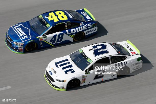 Jimmie Johnson driver of the Lowe's Chevrolet races Brad Keselowski driver of the Miller Lite Ford during the Monster Energy NASCAR Cup Series...