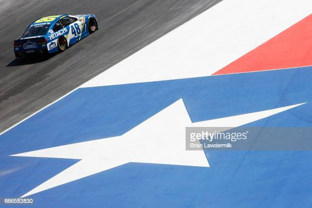 Jimmie Johnson driver of the Lowe's Chevrolet races during the Monster Energy NASCAR Cup Series O'Reilly Auto Parts 500 at Texas Motor Speedway on...