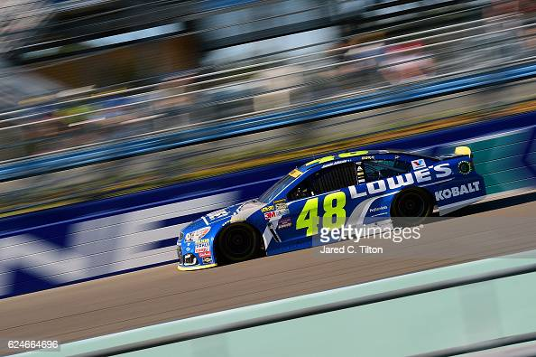 Jimmie Johnson driver of the Lowe's Chevrolet races during the NASCAR Sprint Cup Series Ford EcoBoost 400 at HomesteadMiami Speedway on November 20...