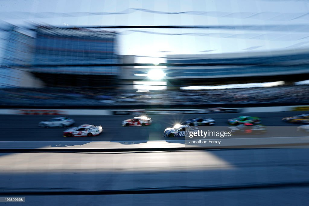 <a gi-track='captionPersonalityLinkClicked' href=/galleries/search?phrase=Jimmie+Johnson+-+Nascar+racerf%C3%B6rare&family=editorial&specificpeople=171519 ng-click='$event.stopPropagation()'>Jimmie Johnson</a>, driver of the #48 Lowe's Chevrolet, races in a pack of cars during the NASCAR Sprint Cup Series AAA Texas 500 at Texas Motor Speedway on November 8, 2015 in Fort Worth, Texas.