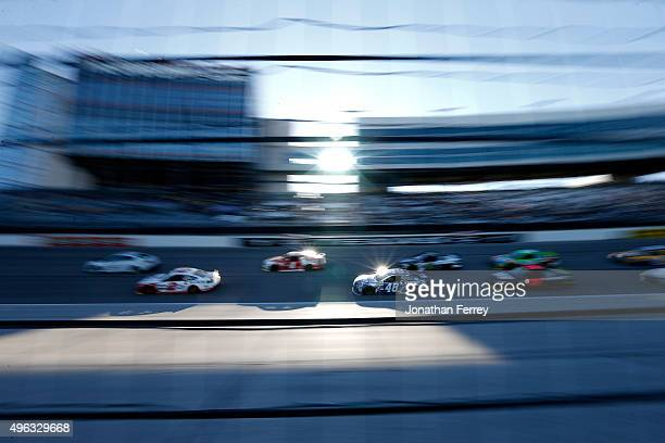 Jimmie Johnson driver of the Lowe's Chevrolet races in a pack of cars during the NASCAR Sprint Cup Series AAA Texas 500 at Texas Motor Speedway on...