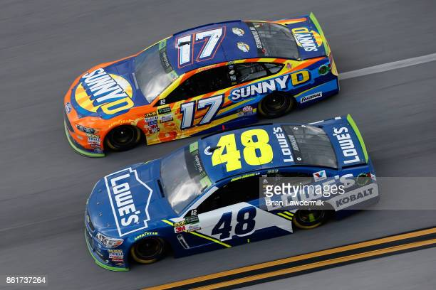Jimmie Johnson driver of the Lowe's Chevrolet races Ricky Stenhouse Jr driver of the SunnyD Ford during the Monster Energy NASCAR Cup Series Alabama...