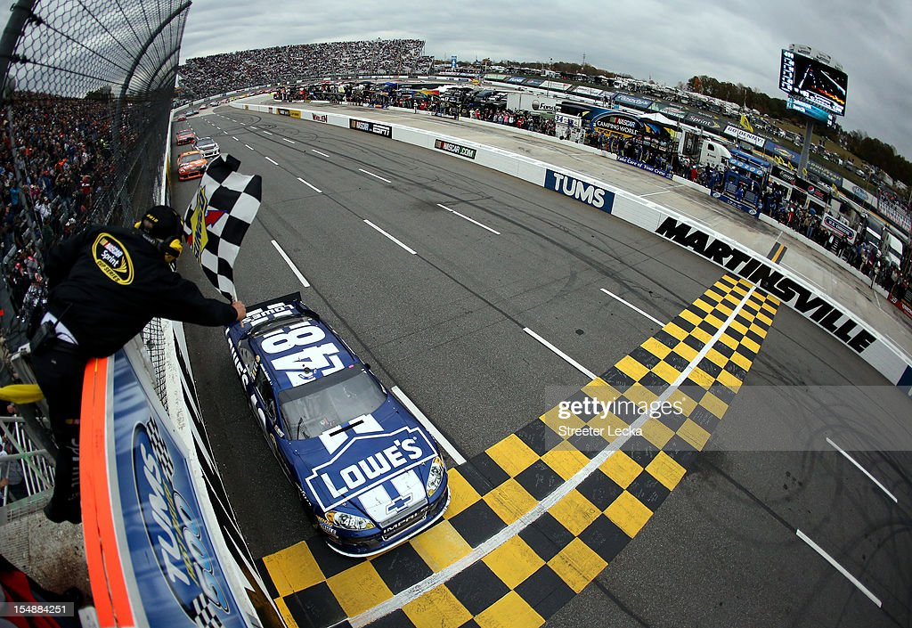 <a gi-track='captionPersonalityLinkClicked' href=/galleries/search?phrase=Jimmie+Johnson+-+Nascar+Race+Driver&family=editorial&specificpeople=171519 ng-click='$event.stopPropagation()'>Jimmie Johnson</a>, driver of the #48 Lowe's Chevrolet, races to the checkered flag to win the NASCAR Sprint Cup Series Tums Fast Relief 500 at Martinsville Speedway on October 28, 2012 in Ridgeway, Virginia.