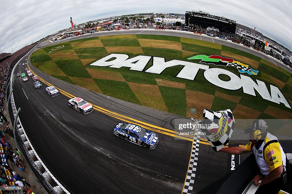 <a gi-track='captionPersonalityLinkClicked' href=/galleries/search?phrase=Jimmie+Johnson+-+Nascar+Race+Driver&family=editorial&specificpeople=171519 ng-click='$event.stopPropagation()'>Jimmie Johnson</a>, driver of the #48 Lowe's Chevrolet, races to the finish line to win the NASCAR Sprint Cup Series Daytona 500 at Daytona International Speedway on February 24, 2013 in Daytona Beach, Florida.