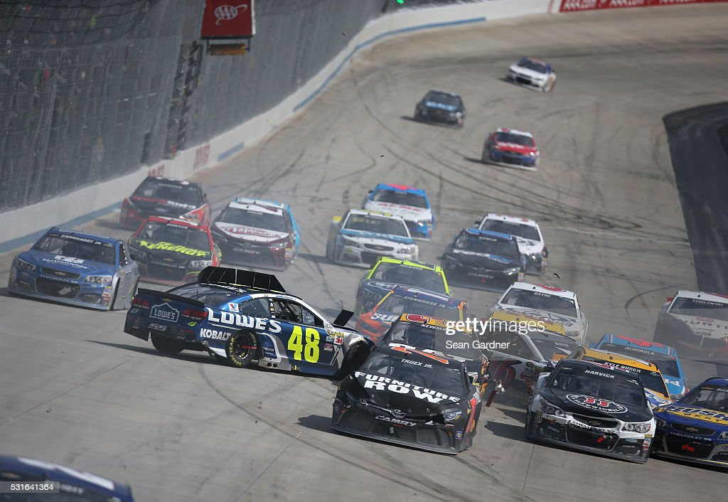 <a gi-track='captionPersonalityLinkClicked' href=/galleries/search?phrase=Jimmie+Johnson+-+Nascar+Race+Driver&family=editorial&specificpeople=171519 ng-click='$event.stopPropagation()'>Jimmie Johnson</a>, driver of the #48 Lowe's Chevrolet, Ricky Stenhouse Jr, driver of the #17 SunnyD Ford, and Martin Truex Jr, driver of the #78 Furniture Row Toyota, are involved in an on-track incident with others during the NASCAR Sprint Cup Series AAA 400 Drive for Autism at Dover International Speedway on May 15, 2016 in Dover, Delaware.
