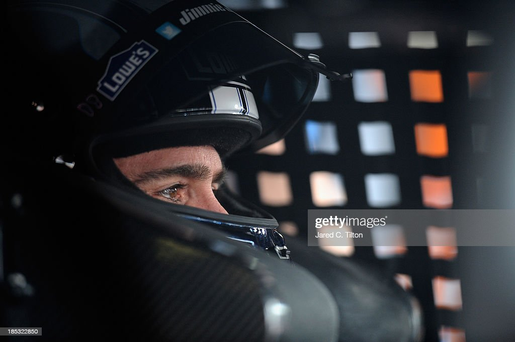 Jimmie Johnson, driver of the #48 Lowe's Chevrolet, sits in his car during practice for the NASCAR Sprint Cup Series 45th Annual Camping World RV Sales 500 at Talladega Superspeedway on October 18, 2013 in Talladega, Alabama.