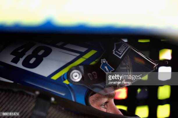 Jimmie Johnson driver of the Lowe's Chevrolet sits in his car during practice for the Monster Energy NASCAR Cup Series O'Reilly Auto Parts 500 at...